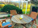 Private outdoor dining with nearby orchard