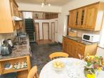 Well equipped kitchen with bedrooms and bathroom leading off