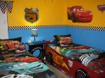Disney Cars themed bedroom with 2 twin beds.  42 inch LED Smart HDTV.