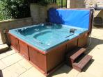 Large Hot Tub Located on large Patio Area,