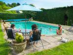 The large outdoor solar heated swimming pool set in beautiful gardens.