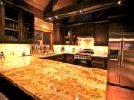 Large granite counter top with barstools