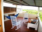 The rocking chairs, hammock and sofa on the top terrace.
