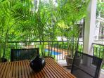 Shaded Private Tropical Terrace With Pool View