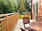 Small outside deck with tree filled backdrop - enclosed, private garden.