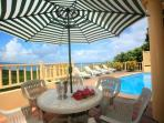 Outside dining with magnificent views of the Caribbean and the pool. Come pop a bottle of champagne
