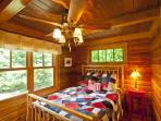 Main level lakeside bedroom with double bed