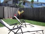 Lounge in the backyard while your pizza is cooking in the outdoor pizza oven.