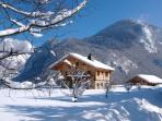 Winter at Chalet Châtelet with an acre of garden leading to sledging slopes