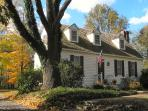 An ancient ash tree shades the Cottage and provides wonderful fall color.