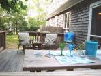 Deck with an area to dine and a gas grill - 23 Deer Run South Harwich Cape Cod New England Vacation Rentals