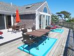 Multiple seating and lounging areas on the wrap around deck! - 19 Bob White Lane South Harwich Cape Cod New England...