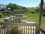 Deck off of the queen bedroom, leads out to the backyard - 19 Bob White Lane South Harwich Cape Cod New England...