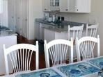 Dining open to kitchen - 2 Captains Row E Chatham Cape Cod New England Vacation Rentals