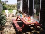 Back patio with picnic table and gas grill - 15 Oyster Drive Chatham Cape Cod New England Vacation Rentals