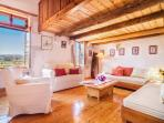The sitting under the attic;a wonderful view;the two sofas can accomodate two persons for sleeping