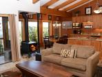 Timber Ridge #50 Living Area With Floor To Ceiling Windows And A Wood Burning Fireplace