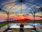 A beautiful wrought-iron gazebo and pool area