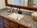 Hand painted tiles in every bathroom