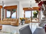 On the lower floor you will find a spacious living room with simple, stylish décor.