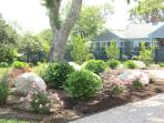 The captivating yard and gardens of this property are professionally designed and maintained.