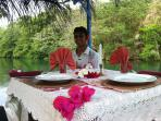 Chef Shavneil preparing the table for a romantic dinner on the water.