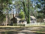 Pine Grove is tucked away on 60 acre tract with private lake across the road from the main ranch