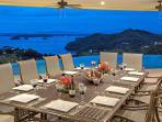 Villa Dining on Outdoor Terrace Under Fans
