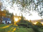 The sun begins to rise behind Fern Cottage
