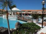 Pool area with sunbeds in the complex 'Tenerife Royal Gardens' (pool is heated in winter)