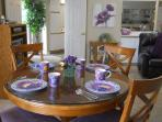 Pretty dishes. New wood dining table and chairs. Many extras to make you smile.  www.MyLakeCondo.com