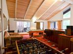 Gameroom upstairs with pool table, darts, foosbal, knock hockey, beautiful custom bar made of local old growth wood...