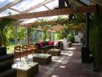 Accessing directly onto the gardens, light and space are in abundance in the conservatory
