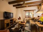 Living room with working kiva fireplace, queen sleeper sofa, and flat screen TV
