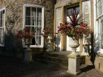 The front steps, great for family photos. We love our urns!