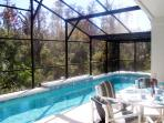 secluded pool, 60ft decking area 4 luxurious sun loungers and a table with 6 chairs