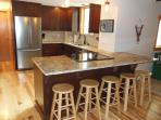 All new kitchen in 2014.  Cherry cabinets, granite, stainless appliances. 6 fit at the breakfast bar