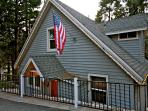 Creekside Lodge with American flag