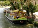 You may want to buy local produce at the floating shop on the Canal
