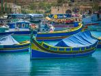 Marsaxlokk seaside with traditional Luzzu boats
