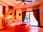 The Romantic Master Bedroom with Patio Doors straight out to the Pool.