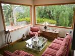 Plenty of light in our living room, read a magazine or a book, enjoy the views...feel at home!