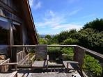Enjoy the ocean & garden views from upstairs deck
