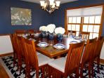 Elegant Dining Room accommodates up to 16 people