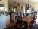 Sunny dining room w/ seating for 8. (Seating for 4 more just through the French doors..)