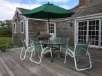 Back deck with gas grill, table and chairs