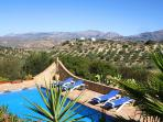 Inviting swimming pool with stunning view over the villages of Axarquia