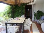 Shaded terrace just outside the kitchen with a comfortable sofa for siestas