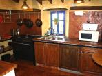 Well equipped kitchen with direct access to garden and terraces