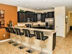 large kitchen with all modern appliances, cosy breakfast bar